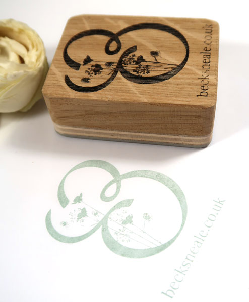 Wooden Stamp of bespoke logo design